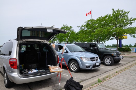 Artists working in their cars to keep warm.  I worked off the back of my van.  Too bad the wind was in my face.  Horizontal flag tells the story.